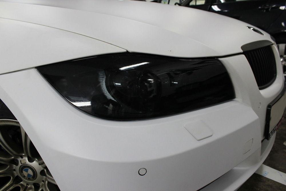 Тонировка фар пленкой на BMW
